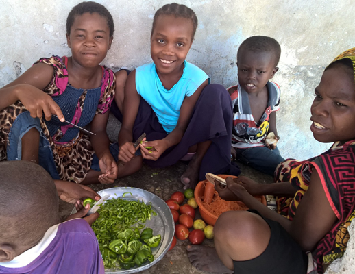 Children in Jambiani cutting vegetables